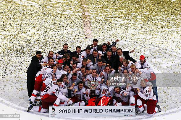 Tomas Rolinek of Czech Republic celebrates with his team mates and the trophy after winning the IIHF World Championship gold medal match between...