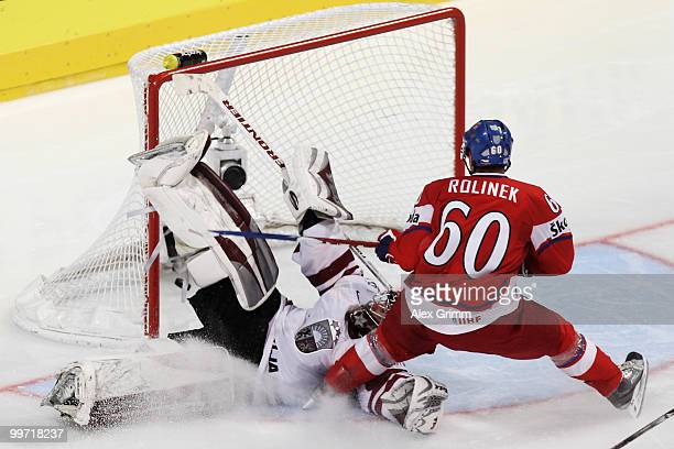 Tomas Rolinek of Czech Republic scores his team's first goal against goalkeeper Edgars Masalskis of Latvia during the IIHF World Championship group F...