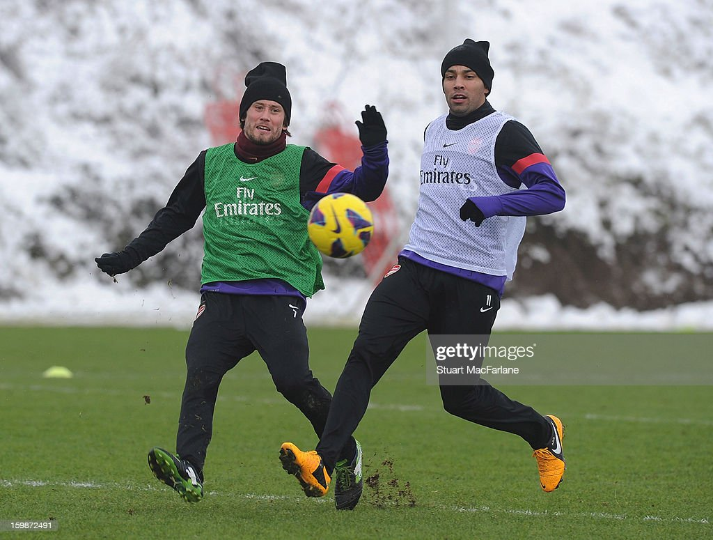 Tomas Rosicky (L) and Andre Santos of Arsenal in action during a training session at London Colney on January 22, 2013 in St Albans, England.