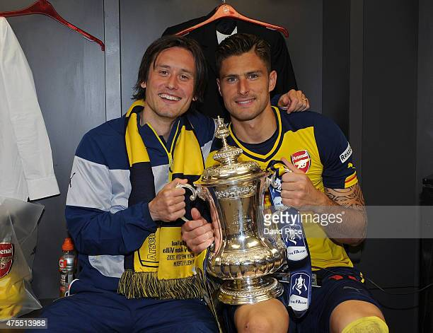 Tomas Rosicky and Olivier Giroud of Arsenal in the changingroom with the FA Cup Trophy after the match between Arsenal and Aston Villa in the FA Cup...