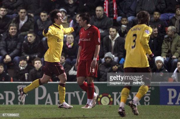 Tomas Rosicky celebrates scoring his side's first goal of the game, as Leyton Orient's Charlie Daniels looks on