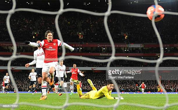Tomas Rosicky chips the ball over Tottenham goalkeeper Hugo Lloris to score the 2nd Arsenal goal during the Budweiser FA Cup third round match...