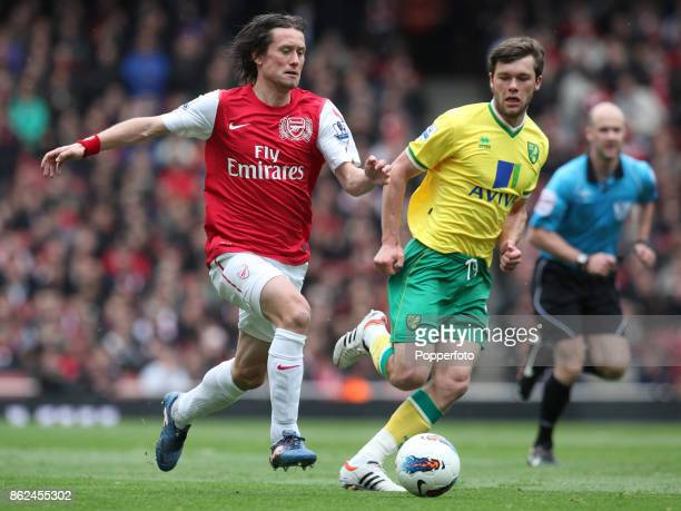 Tomas Rosicky of Arsenal and Jonny Howson of Norwich City in action during the Barclays Premier League match between Arsenal and Norwich City at the...