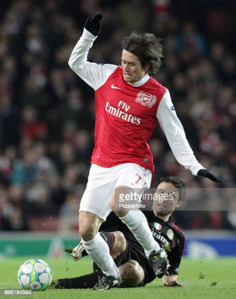 Tomas Rosicky of Arsenal and Mark van Bommel in action during a UEFA Champions League match at the Emirates Stadium on March 06 2012 in London England