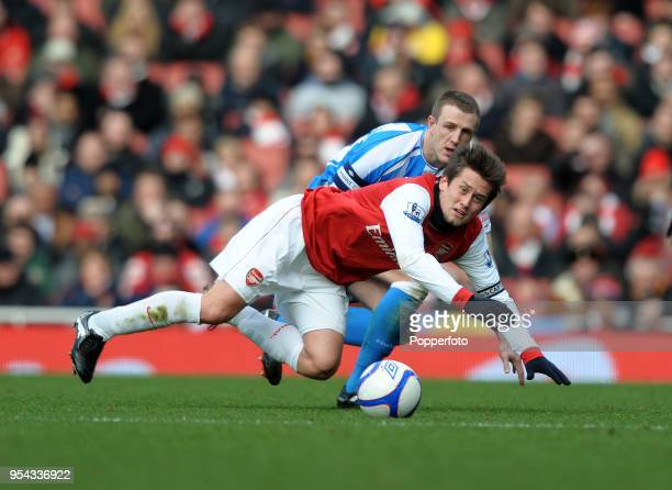 Tomas Rosicky of Arsenal and Peter Clark of Huddersfield battling for the ball during the FA Cup sponsored by EON 4th round match between Arsenal and...