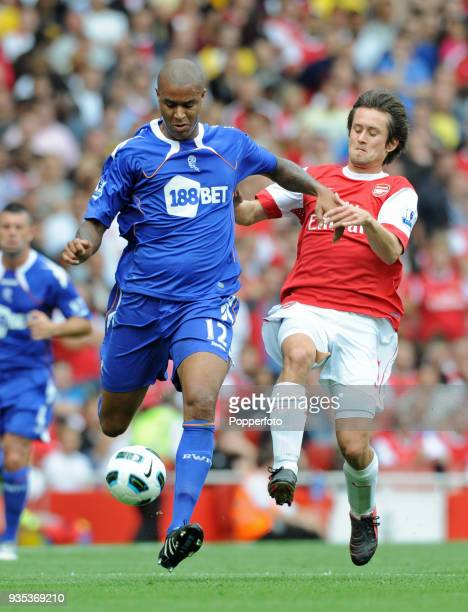 Tomas Rosicky of Arsenal and Zat Knight of Bolton Wanderers in action during the Barclays Premier League match between Arsenal and Bolton Wanderers...