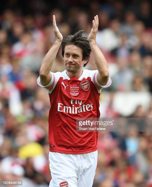 Tomas Rosicky of Arsenal applauds during the match between Arsenal Legends and Real Madrid Legends at Emirates Stadium on September 8, 2018 in...