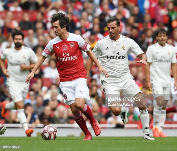Tomas Rosicky of Arsenal breaks past Francisco Pavon of Real Madrid during the match between Arsenal Legends and Real Madrid Legends at Emirates...