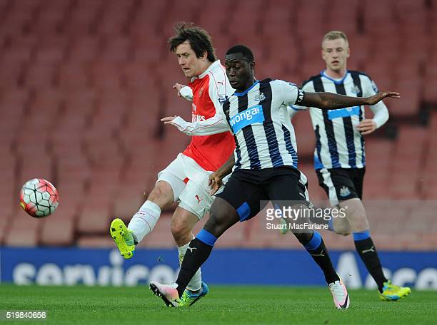 Tomas Rosicky of Arsenal breaks past Henri Saivet of Newcastle during the Barclays Premier League match between Arsenal and Newcastle United at...