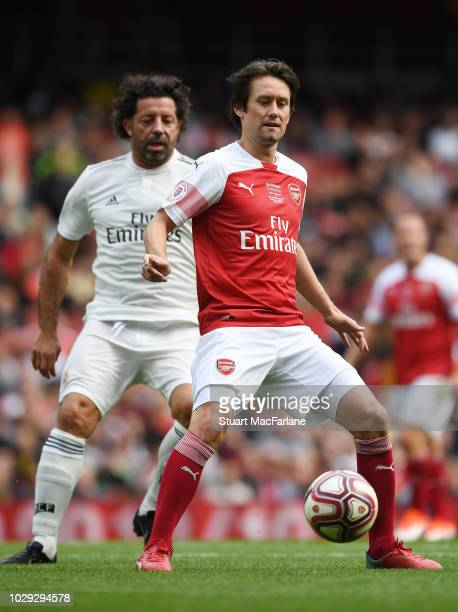 Tomas Rosicky of Arsenal breaks past Ivan Campo of Real Madrid during the match between Arsenal Legends and Real Madrid Legends at Emirates Stadium...