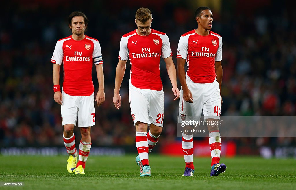 Tomas Rosicky of Arsenal, Calum Chambers of Arsenal and Isaac Hayden of Arsenal look down during the Capital One Cup Third Round match between Arsenal and Southampton at the Emirates Stadium on September 23, 2014 in London, England.
