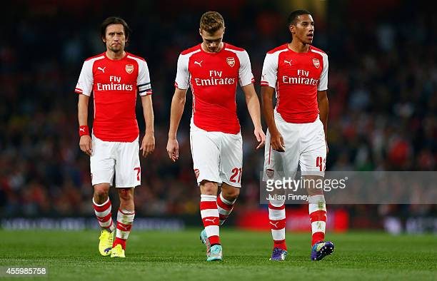 Tomas Rosicky of Arsenal Calum Chambers of Arsenal and Isaac Hayden of Arsenal look down during the Capital One Cup Third Round match between Arsenal...