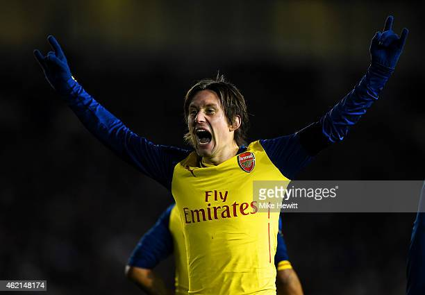 Tomas Rosicky of Arsenal celebrates after scoring his team's third goal during the FA Cup Fourth Round match between Brighton & Hove Albion and...
