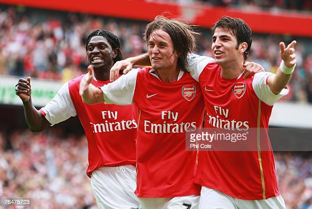 Tomas Rosicky of Arsenal celebrates Arsenal's third goal with Emmanuel Adebayor and Cesc Fabregas during the Barclays Premier League match between...