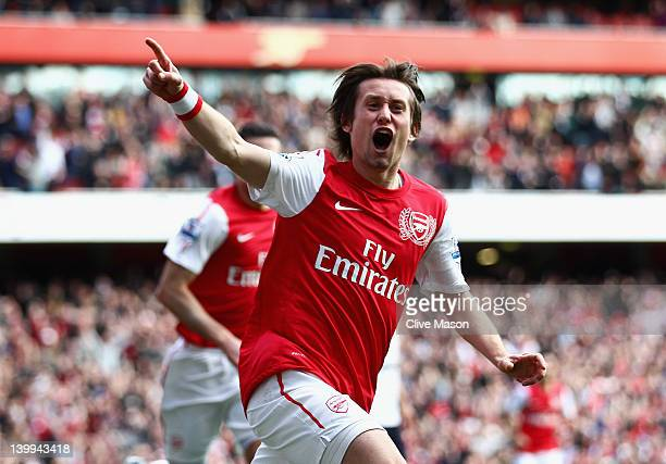 Tomas Rosicky of Arsenal celebrates his goal during the Barclays Premier League match between Arsenal and Tottenham Hotspur at Emirates Stadium on...