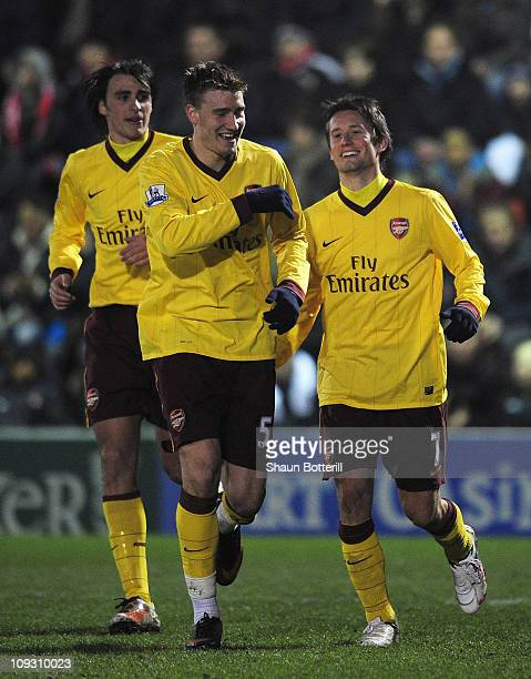 Tomas Rosicky of Arsenal celebrates scoring the opening goal with Nicklas Bendtner during the FA Cup sponsored by E.ON 5th Round match between Leyton...