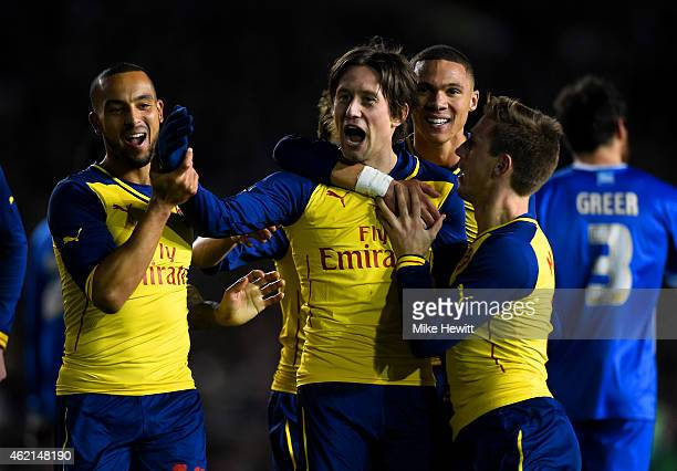 Tomas Rosicky of Arsenal celebrates with team-mates after scoring his team's third goal during the FA Cup Fourth Round match between Brighton & Hove...
