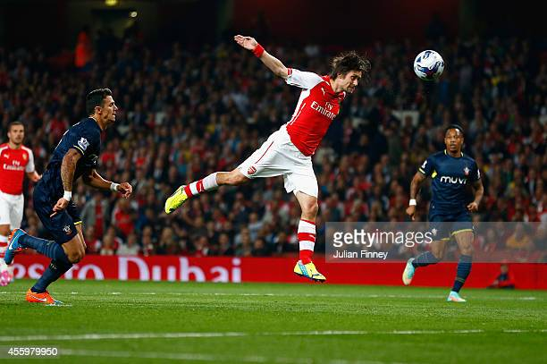 Tomas Rosicky of Arsenal heads towards goal during the Capital One Cup Third Round match between Arsenal and Southampton at the Emirates Stadium on...