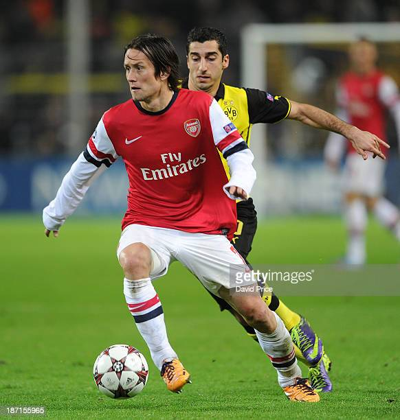 Tomas Rosicky of Arsenal holds off Henrikh Mkhitaryan of Dortmund during the UEFA Champions League Group F match between Borussia Dortmund and...