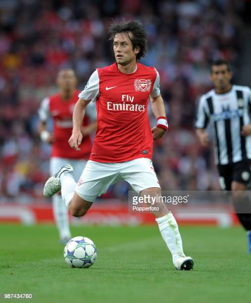 Tomas Rosicky of Arsenal in action during the UEFA Champions League playoff first leg match between Arsenal and Udinese at the Emirates Stadium in...