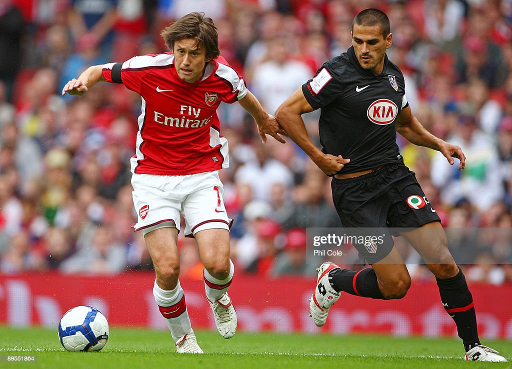 Tomas Rosicky Of Arsenal Is Challenged By Juanito Of Athletico During The Emirates Cup Match Between