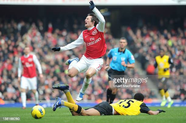 Tomas Rosicky of Arsenal is fouled by Blackburn's Steven Nzonzi during the Barclays Premier League match between Arsenal and Blackburn Rovers at...