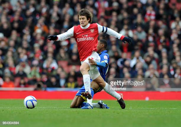 Tomas Rosicky of Arsenal is tackled by Sanchez Watt of Leeds United during the FA Cup sponsored by EON 3rd Round match between Arsenal and Leeds...