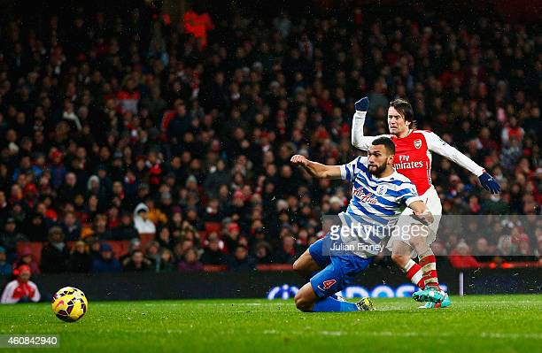 Tomas Rosicky of Arsenal scores his team's second goal during the Barclays Premier League match between Arsenal and Queens Park Rangers at Emirates...