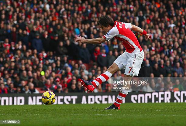 Tomas Rosicky of Arsenal scores their second goal during the Barclays Premier League match between Arsenal and Everton at Emirates Stadium on March...