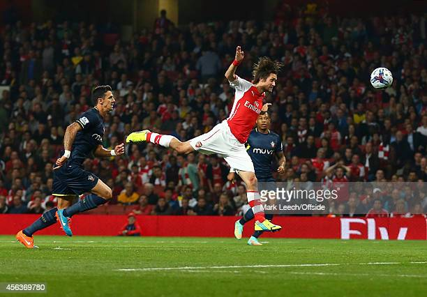 Tomas Rosicky of Arsenal with a headed effort on goal during the Capital One Cup Third Round between Arsenal and Southampton at Emirates Stadium on...