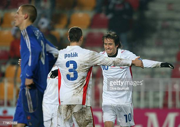 Tomas Rosicky of Czech Republic celebrates scoring the third and winning goal with team mate Jan Polak during the Euro 2008 Group D qualifying match...