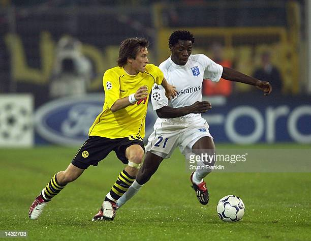 Tomas Rosicky of Dortmund and Benjani of Auxerre during The Champions League group A match between BV Borussia Dortmund and AJ Auxerre at The...