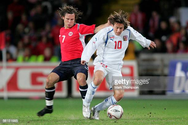 Tomas Rosicky of the Czech Republic tangles with Kristofer Haestad of Norway during the World Cup 2006 playoff match between Norway and The Czech...