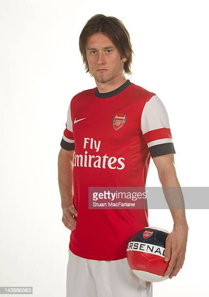 Tomas Rosicky poses during a photoshoot for the new Arsenal home kit for season 2012/13 at London Colney on April 5 2012 in St Albans England