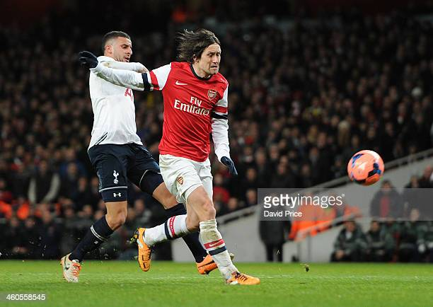 Tomas Rosicky scores Arsenal's 2nd under pressure from Kyle Walker of Tottenham during the FA Cup 3rd Round match between Arsenal and Tottenham...