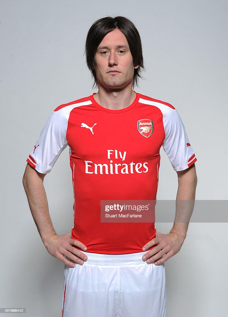 watch bda92 4d438 Tomas Rosicky wears the new Puma Arsenal kit for season 2013 ...