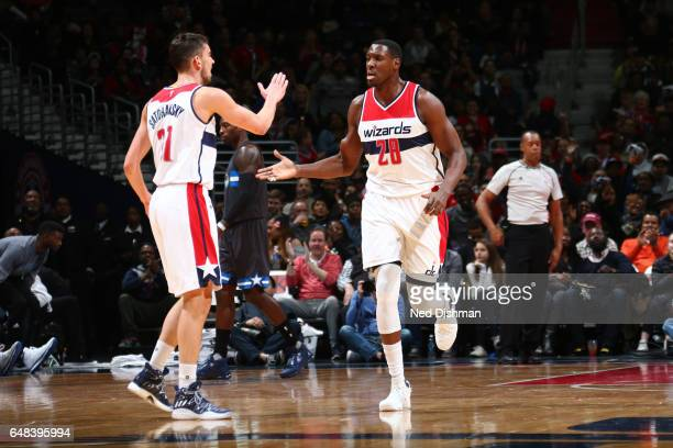 Tomas Satoransky and Ian Mahinmi of the Washington Wizards highfive during a game against the Orlando Magic on March 5 2017 at Verizon Center in...