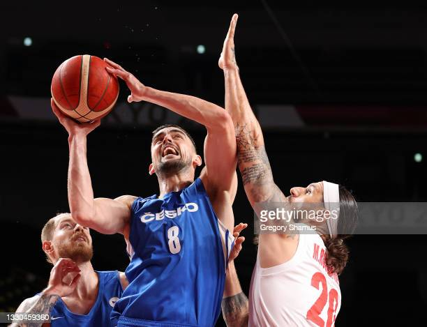 Tomas Satoransky of Team Czech Republic goes up for a shot against Michael Rostampour of Team Iran during the second half on day two of the Tokyo...