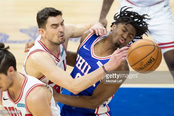 Tomas Satoransky of the Chicago Bulls and Tyrese Maxey of the Philadelphia 76ers collide going for the ball in the second quarter at Wells Fargo...