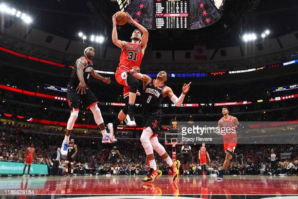 Tomas Satoransky of the Chicago Bulls drives to the basket against Russell Westbrook of the Houston Rockets during the second half of a game at...