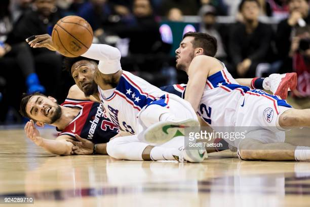 Tomas Satoransky of the Washington Wizards and Robert Covington of the Philadelphia 76ers vie for the ball during the second half at Capital One...