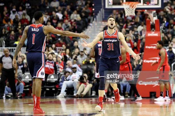 Tomas Satoransky of the Washington Wizards celebrates scoring with Trevor Ariza in the second half against the Toronto Raptors at Capital One Arena...