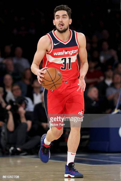 Tomas Satoransky of the Washington Wizards dribbles down the court against the New York Knicks during their Pre Season game at Madison Square Garden...