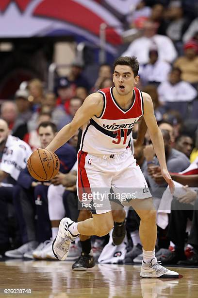 Tomas Satoransky of the Washington Wizards dribbles the ball against the San Antonio Spurs at Verizon Center on November 26 2016 in Washington DC...