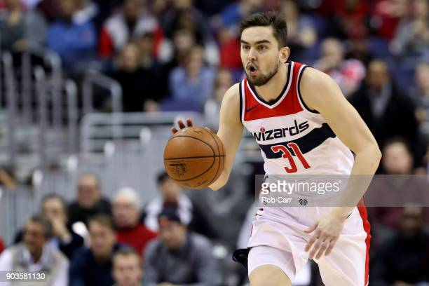Tomas Satoransky of the Washington Wizards dribbles the ball against the Utah Jazz in the first half at Capital One Arena on January 10 2018 in...