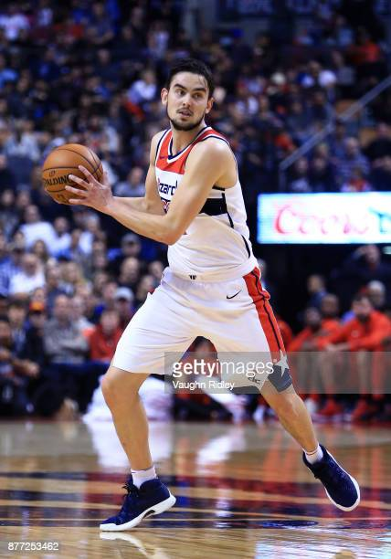 Tomas Satoransky of the Washington Wizards dribbles the ball during the first half of an NBA game against the Toronto Raptors at Air Canada Centre on...
