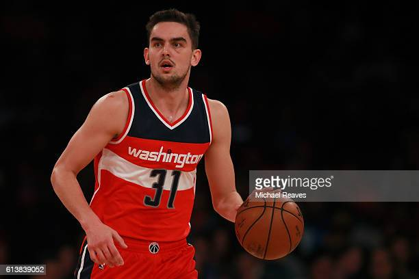 Tomas Satoransky of the Washington Wizards dribbles up the court against the New York Knicks in the second half of the preseason game at Madison...