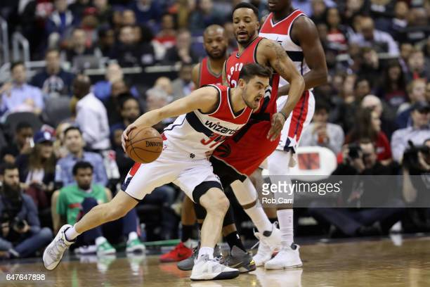 Tomas Satoransky of the Washington Wizards drives around Norman Powell of the Toronto Raptors in the first half at Verizon Center on March 3 2017 in...
