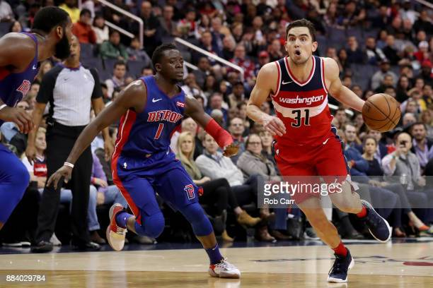 Tomas Satoransky of the Washington Wizards drives around Reggie Jackson of the Detroit Pistons in the second half at Capital One Arena on December 1...