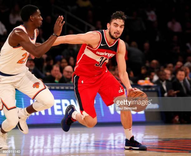 Tomas Satoransky of the Washington Wizards drives past Damyean Dotson of the New York Knicks in an NBA basketball game on October 13 2017 at Madison...